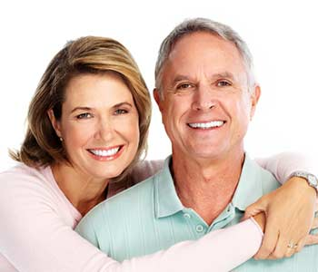 Happy and smiling couple in front of white background